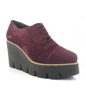 Zapatos de cordones y cuña alta